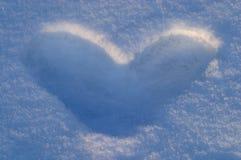Forme de coeur de neige Photographie stock libre de droits