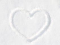 Forme de coeur de neige Photo stock