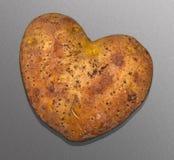 Forme de coeur de pomme de terre Image stock