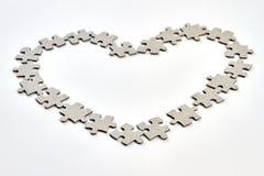 Forme de coeur des éléments de puzzle Images libres de droits