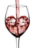 Forme de coeur du vin rouge Images stock