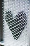 Forme de coeur en métal Photographie stock libre de droits