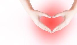 Forme de coeur faisant des mains Photo stock