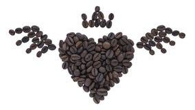Forme de coeur faite à partir des grains de café Image stock