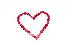 Forme de coeur faite de boutons rouges Photo stock
