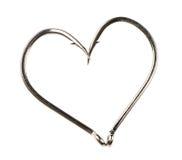 Forme de coeur faite de deux hameçons Images stock