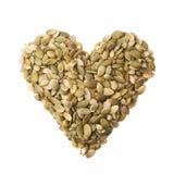 Forme de coeur faite de graines de citrouille Images libres de droits
