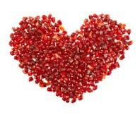 Forme de coeur faite de graines de grenade Image libre de droits