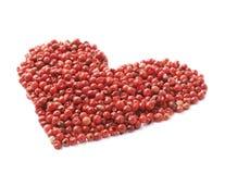 Forme de coeur faite de graines de poivre Image libre de droits