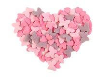 Forme de coeur formée avec des coeurs de sucre et Photo stock