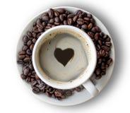 Forme de coeur ou symbole d'amour sur la tasse de café Photographie stock libre de droits