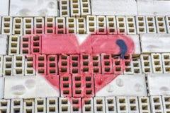 Forme de coeur peinte par rouge Images stock