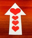 Forme de coeur sur la flèche Image stock