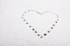 Forme de coeur sur la neige Image libre de droits