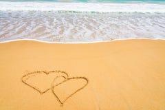 Forme de coeur sur la plage Photos libres de droits
