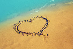 Forme de coeur sur la plage Photographie stock libre de droits
