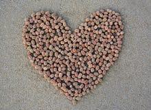 Forme de coeur sur le sable Photos libres de droits