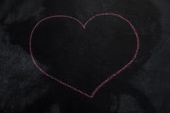 Forme de coeur sur le tableau noir Photographie stock libre de droits