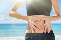 Forme de foyer sur l'abdomen Photo stock