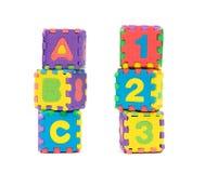 Forme de puzzle d'alphabet en tant que blocs sur le blanc Photographie stock libre de droits