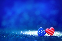 Forme del cuore della bandiera americana sul fondo leggero astratto di scintillio Fotografia Stock Libera da Diritti