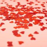 Forme del cuore sopra la superficie di rosa Fotografia Stock