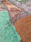 Forme del marciapiede prima del versamento del fondo del cemento Fotografie Stock Libere da Diritti