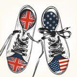 Forme el fondo con las botas de los deportes adornadas por británicos y los E.E.U.U. Imagen de archivo