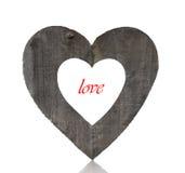 Forme en bois de coeur et amour rouge Photo libre de droits