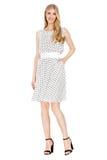 Forme a foto da mulher magnífica nova que veste a roupa elegante do verão Fotografia de Stock