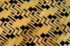 Forme graphique d'un métal de couleurs d'or photographie stock libre de droits