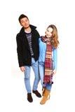 Forme a la gente joven en la ropa del invierno aislada en blanco Fotografía de archivo