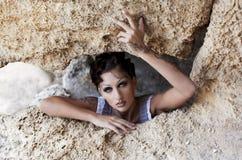La muchacha en la cueva Imagen de archivo libre de regalías