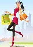 Forme a las muchachas de compras con el bolso de compras