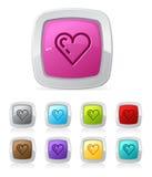 forme lustrée de coeur de bouton Photographie stock