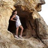 A menina na caverna fotografia de stock royalty free