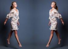 Forme o retrato da beleza da mulher bonita nova que salta sobre a GR Imagens de Stock