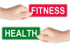 Forme physique et santé poteau de signalisation dedans la main Image stock