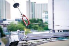 """Forme rouge de """"O """"d'outil de fixation pour le câble en acier accrochant de bride image stock"""