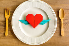 Forme rouge de coeur avec des ailes Photographie stock