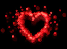 Forme rouge de coeur de bokeh Photos stock