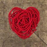 Forme rouge de coeur de perle de fil Photographie stock libre de droits