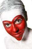 Forme rouge de coeur peinte par visage Photos libres de droits