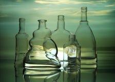 Forme trasparenti vuote delle bottiglie di vetro immagine stock