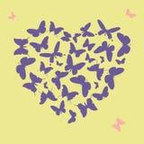 Forme ultra-violette de coeur faite à partir des silhouettes de papillon Images stock