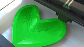 Forme verte en plastique de coeur d'impression avec une imprimante 3D, rendu 3D Image stock
