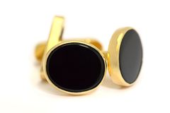 Or formel et boutons de manchette noirs ovales d'onyx Photo stock