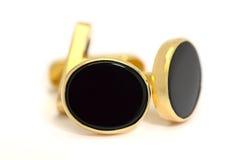 Formele gouden en ovale zwarte onyxcufflinks Stock Foto