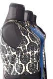 Formell klädersamling på skyltdockor i modelager Fotografering för Bildbyråer