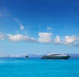 Formentera boats with Ibiza Es Vedra Balearic stock photography